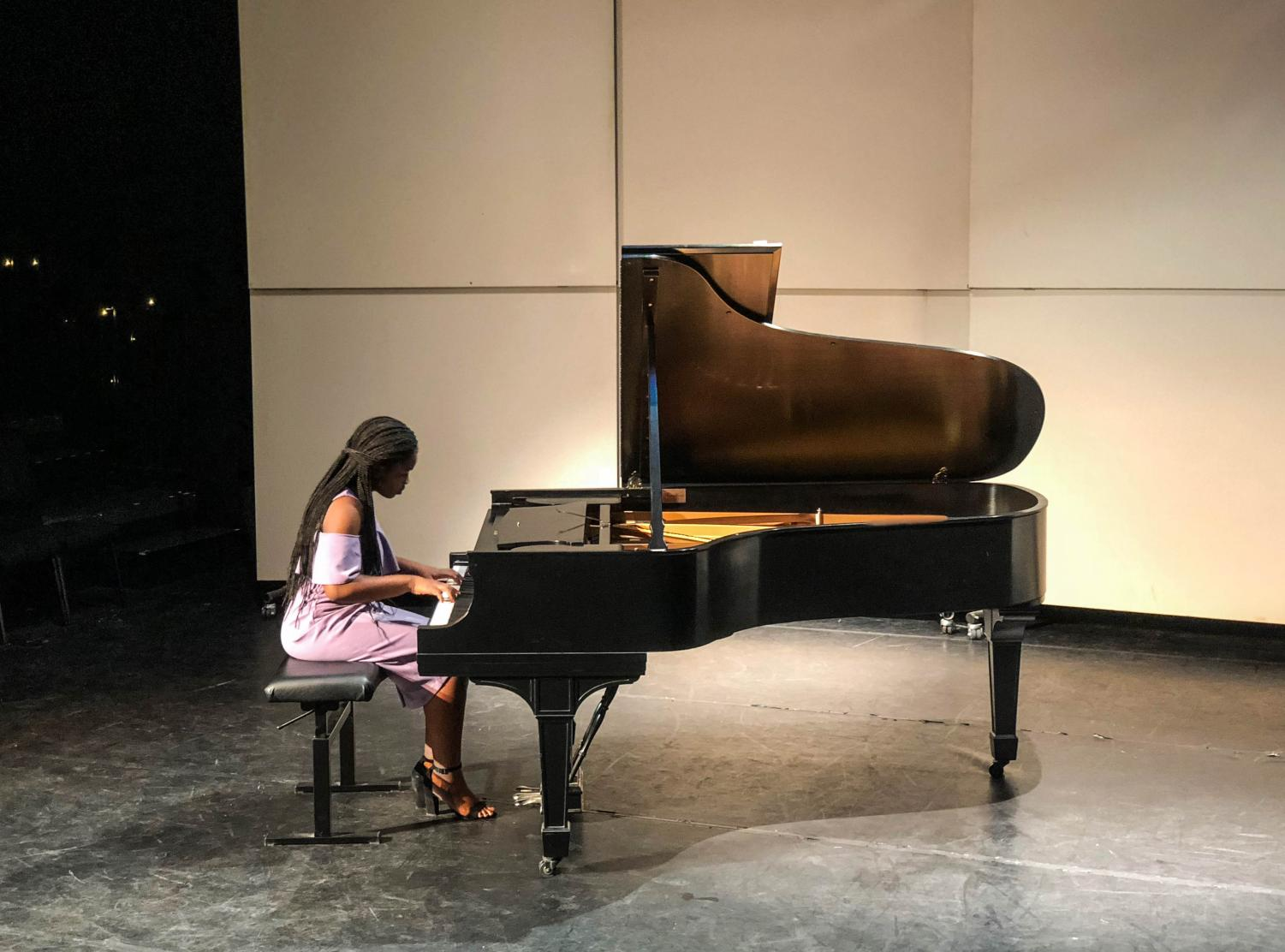 "Piano sophomore Erica Samuel plays ""Sonata K. 280 in F Major, Allegro assai,"" by Mozart. ""I wanted to play something classical, I have already played something romantic,"" Samuel said.  ""I wanted to play something different [this time]."""