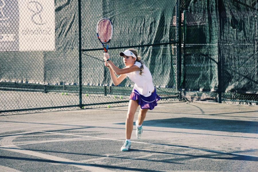 Communications+senior+Brianna+Seaberg+follows+through+with+her+tennis+racket+after+returning+the+ball+to+her+opponent.+This+year+marks+the+fourth+year+that+Seaberg+has+played+for+the+Dreyfoos+tennis+team+and+the+first+that+she+has+been+co-captain.+Along+with+her+many+other+interests%2C+especially+film%2C+tennis+is+a+special+part+of+Seaberg%E2%80%99s+life+that+she+values+as+one+of+her+favorite+activities.+%E2%80%9CMy+favorite+part+about+tennis+is+that+you+have+to+solely+rely+on+yourself%2C%E2%80%9D+Seaberg+said.+%E2%80%9CSince+tennis+is+an+individual+sport%2C+you+can+have+control+over+every+aspect+of+your+own+game.%E2%80%9D%0A