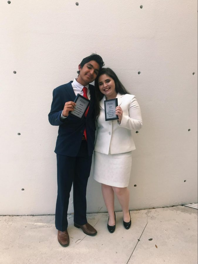 Communications+freshman+Nirmit+Chandan+poses+with+communications+senior+Maya+Levkovitz+moments+after+receiving+their+awards+for+Congressional+Debate.+Both+Chandan+and+Levkovitz+qualified+for+the+2018+National+Speech+and+Debate+Tournament+on+June+17+through+22+in+Fort+Lauderdale.%0A