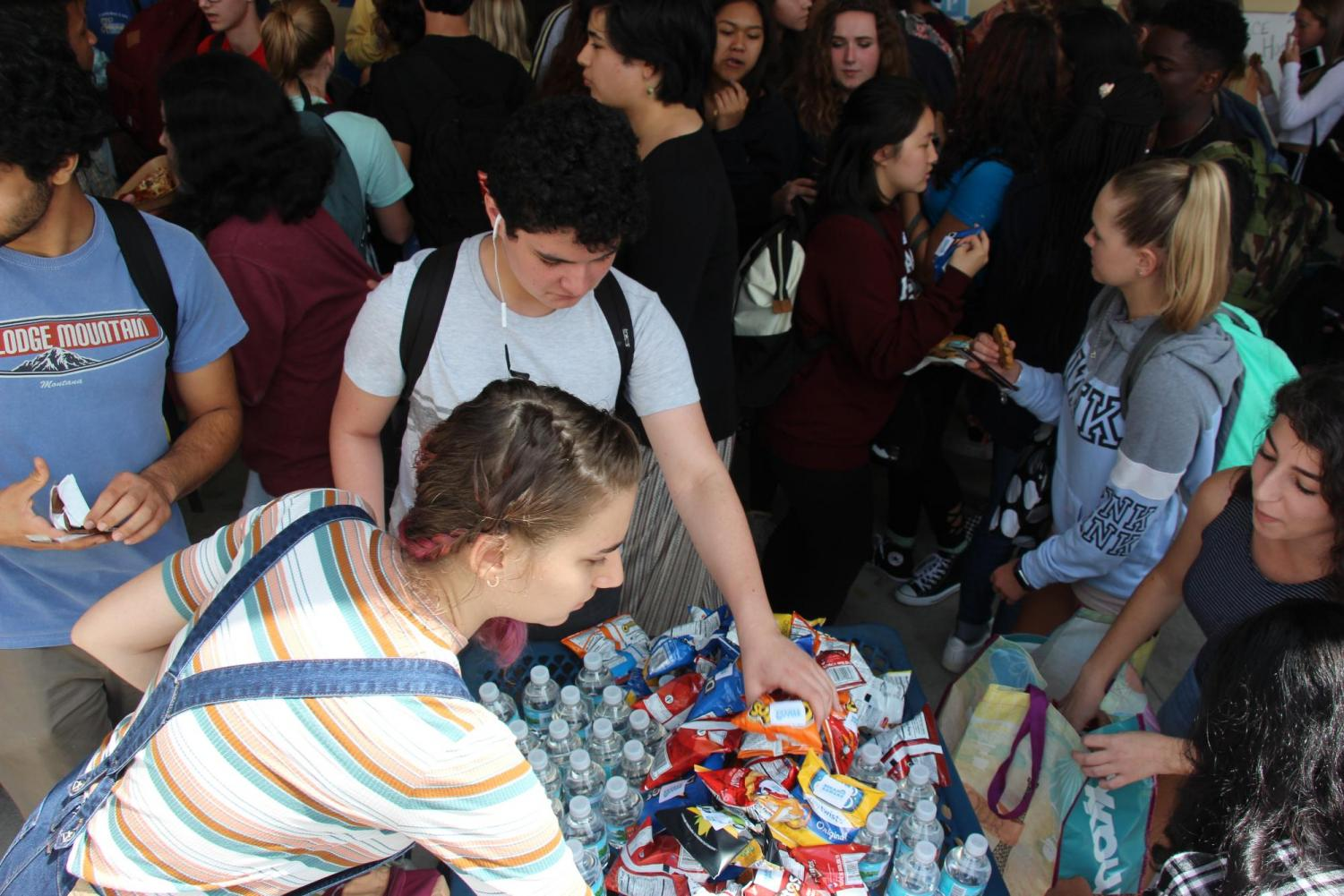 Students receive edible handouts from SGA and Class Council around the cafeteria during lunch. Throughout the week, candidates passed out a multitude of treats in order to entice voters.
