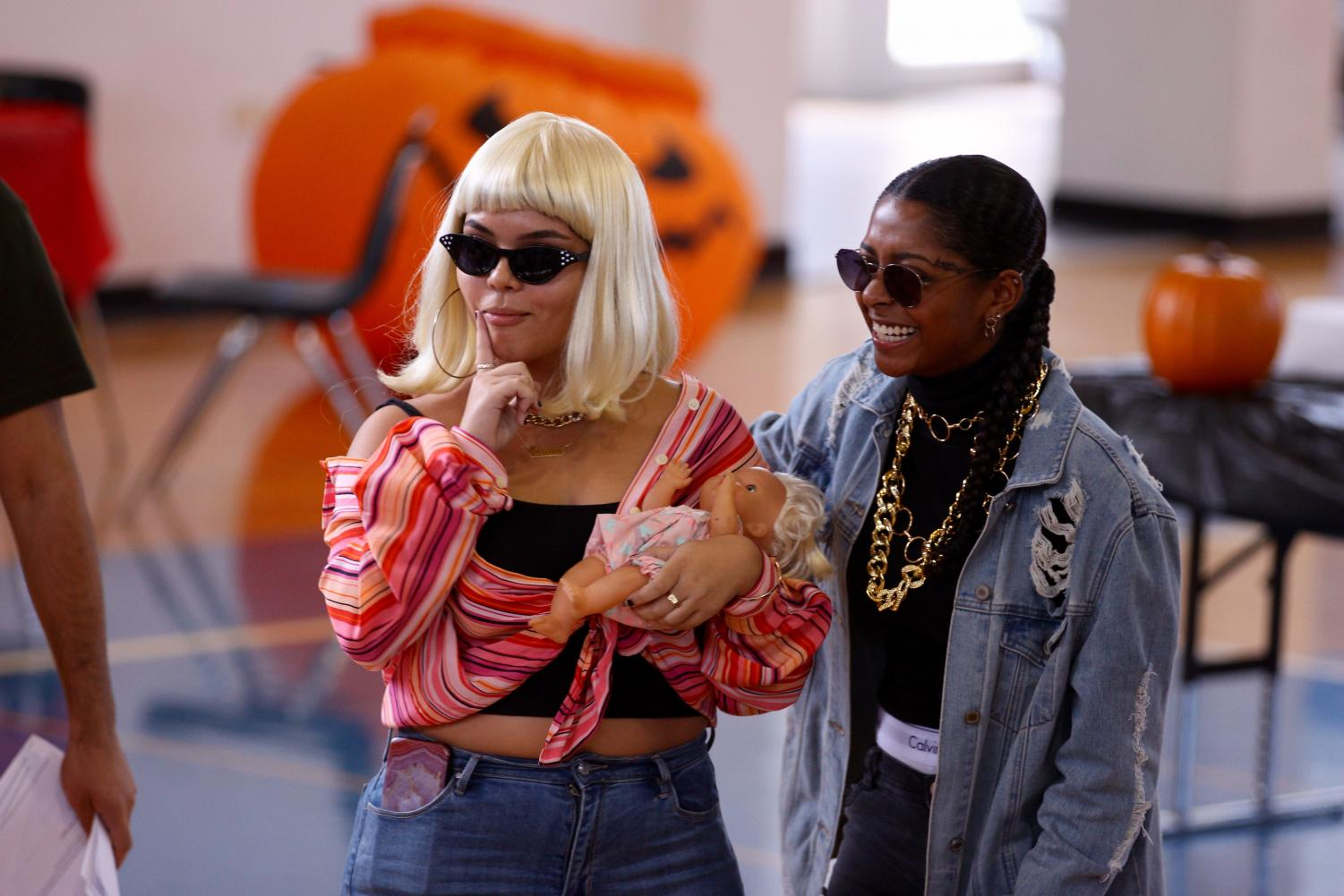 "Dance seniors Mariana Mona and Gabriella Angel posed and screamed, riling up the crowd of eager students. Their costumes depicted pop culture icons Cardi B and Offset, winning the costume contest. ""So I guess I have always been a pretty big Cardi fan,"" Mona said. ""I have always loved her, and I wanted to be something funny and different which is usually her, which is why I brought the baby, and it kind of just worked out."""