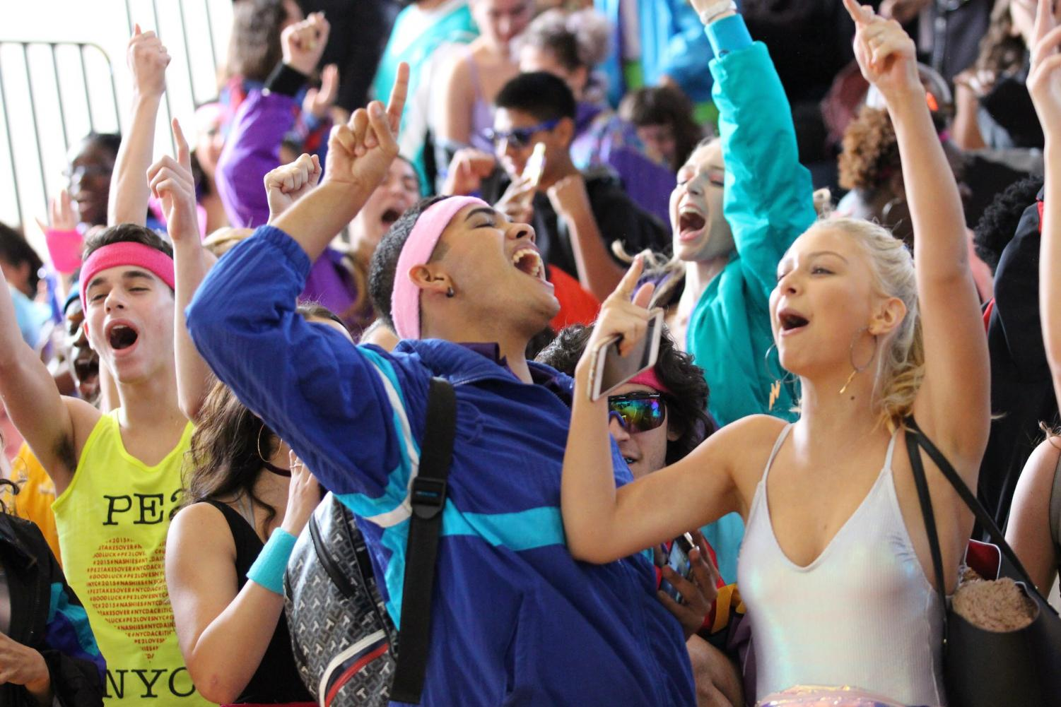 Pointing his finger up in the air, theatre senior Jaden Martinez cheers alongside fellow seniors after winning first place for their 80's Generation Day dance. Shortly after, it was announced that there was a mishap in the judges' scoring and that the juniors tied with the seniors.