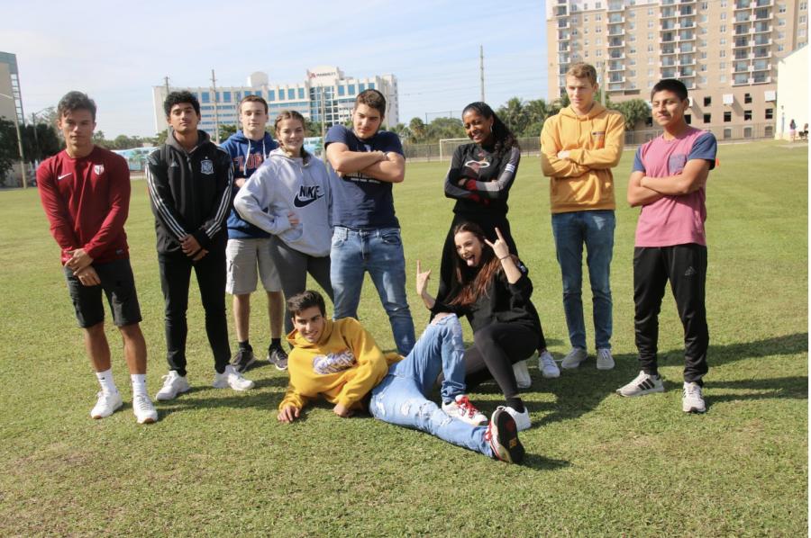 Seniors+strike+a+pose+before+the+start+of+the+annual+kickball+game.+