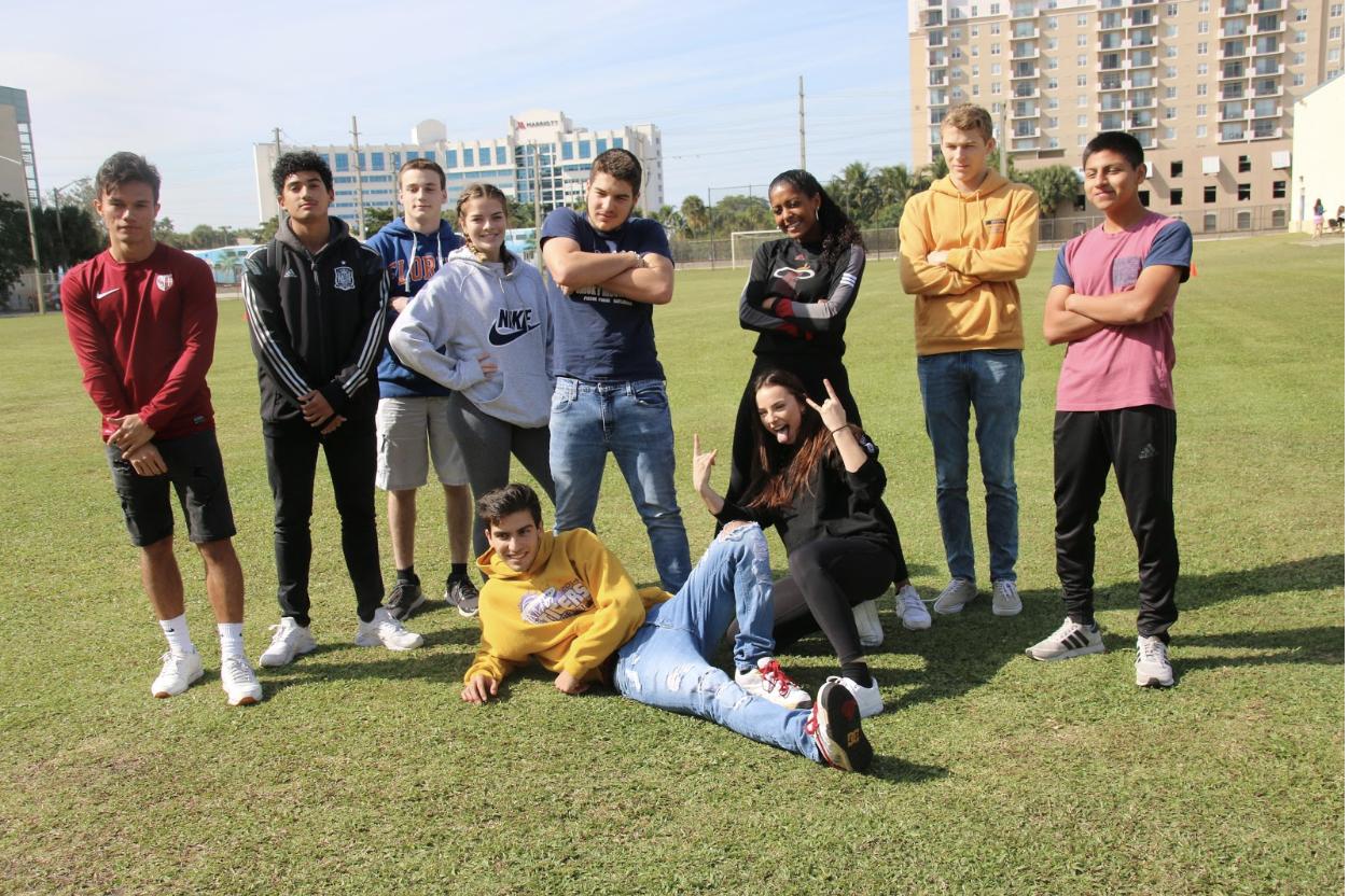 Seniors strike a pose before the start of the annual kickball game.