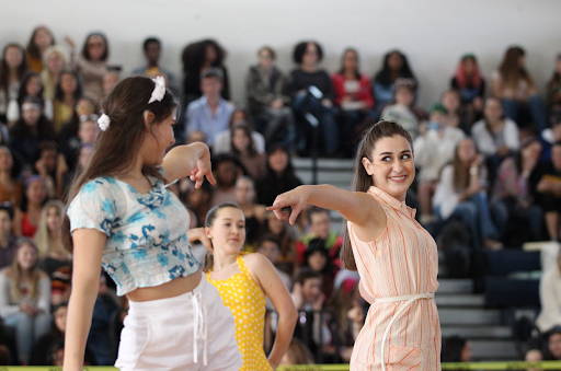 Dance sophomore Morgan Jourdin points to another dancer in the sophomore routine as they kick to beachy '60s music. The sophomores ended up in third place for the dance, placing behind the juniors and seniors who tied for first.