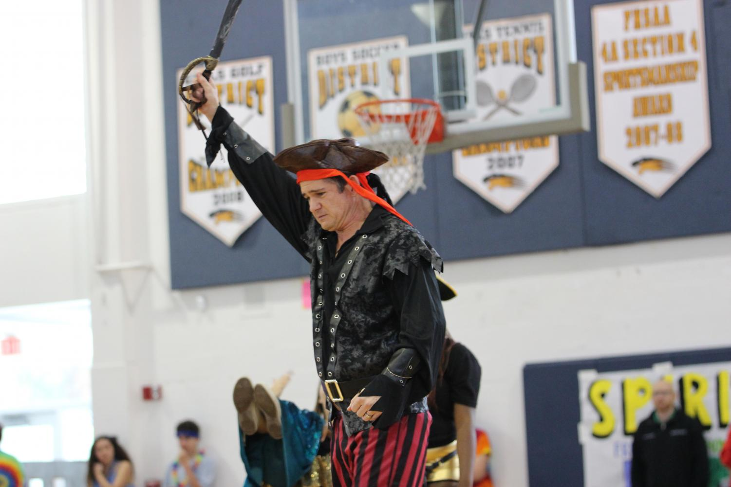 "After being asked by his senior students, social studies teacher David Pardo took on the role of a pirate during the senior skit at Pep Rally. ""I was shocked at how much time and energy was put into [Pep Rally], both by the students and the staff,"" Mr. Pardo said. Although he enjoyed participating, Mr. Pardo hopes just to be a part of the audience in next year's Pep Rally."