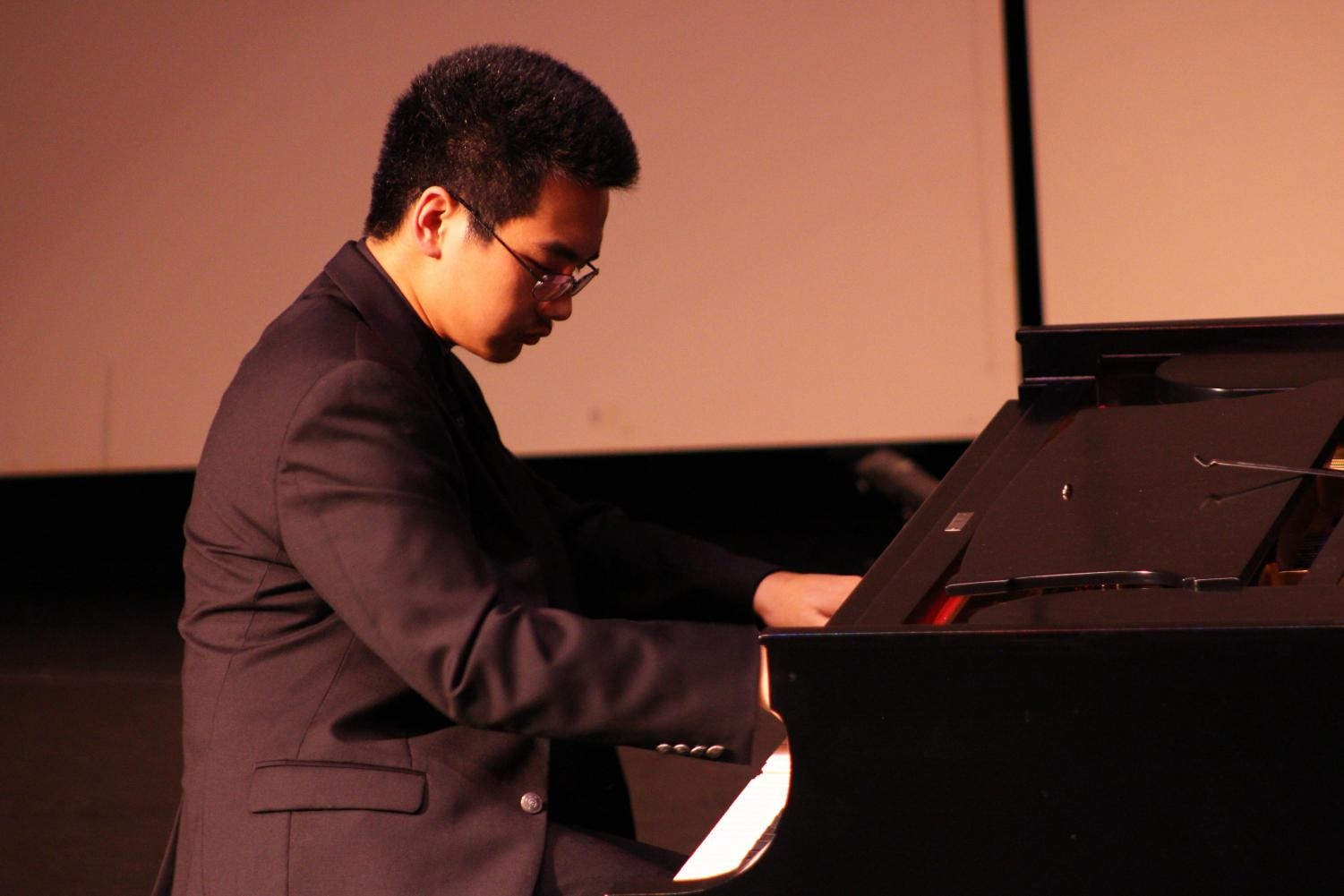 """Piano sophomore Daniel Wang plays Sonata Op. 22 No. 11 in B-flat Major (Movement 1) by Beethoven. It was the second piece he played during the recital, after Prelude and Fugue in A-flat Major, BWV 862 by Bach. """"In the beginning, I actually didn't enjoy performing,"""" Wang said. """"Eventually I came to enjoy it because I want to be able to perform music to an audience and make the audience feel what I feel when I practice."""""""