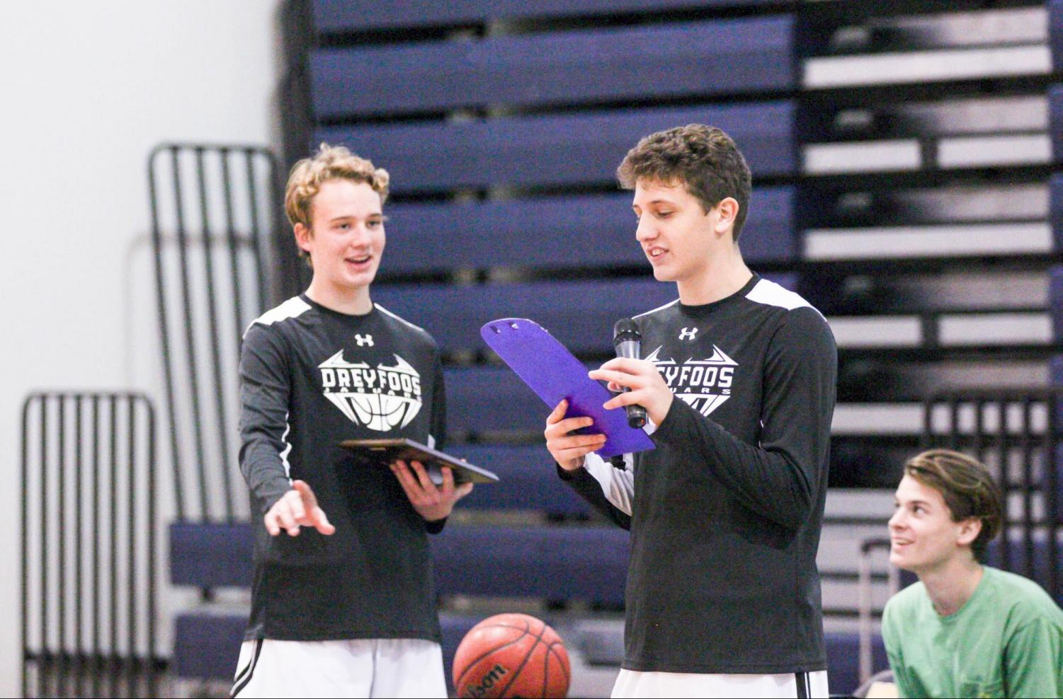 Basketball+team+Co-Captain+and+digital+media+junior+Caleb+Holzhauer+reads+the+names+of+the+seniors+listed+in+front+of+him.+Being+a+rising+senior%2C+Holzhauer+anticipates+next+year+having+%E2%80%9Ca+fresh+start+where+%5Bthe+team%5D+can+have+a+winning+record+and+another+memorable+season.%E2%80%9D