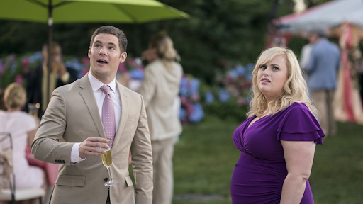 Natalie (Rebel Wilson) and Josh (Adam DeVine) have a conversation about relationships as Josh prepares to marry Isabella (Priyanka Chopra) in the alternate rom-com universe depicted in the film.