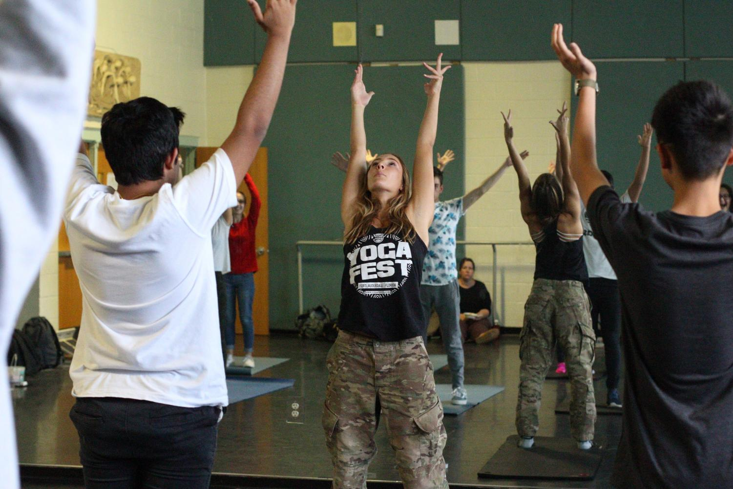 Visual senior Paige Duffack leads students in yoga as they learn ways to live life with a healthy mentality and physicality.