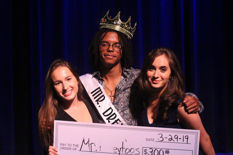 After being crowned Mr. Dreyfoos, visual senior Njari Anderson stands alongside digital media junior Kristina Ronan and communications junior Sasha Monaco.