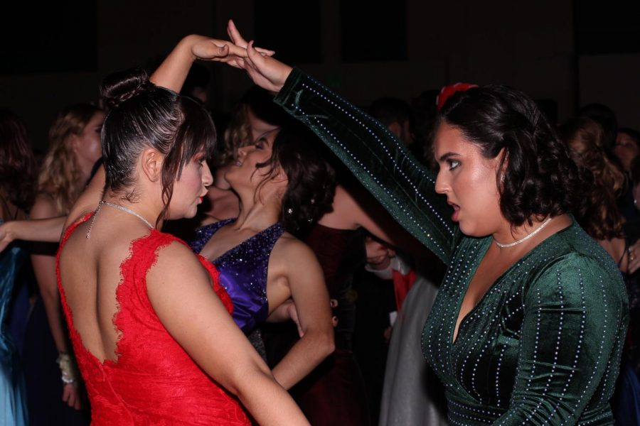Visual+senior+Lily+Moore+and+digital+media+senior+Laura+Cruz+dance%2C+wearing+colorful+dresses.+Prom%2C+thrown+for+the+juniors+and+seniors%2C+was+held+at+the+Palm+Beach+County+Convention+Center.