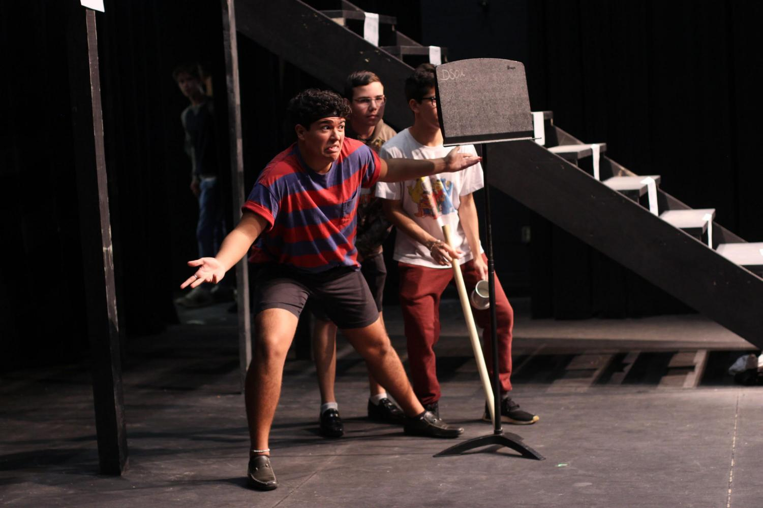 "Theatre junior Juan Carlos Romero, freshman Alrik Blanchard, and sophomore Aaron Idlis musically narrate Amélie's father's introduction in rehearsals for ""Amélie."" ""Amélie"" is the first full-scale musical to occupy the Brandt Black Box Theater, complete with a 12-piece band and multi-leveled set."