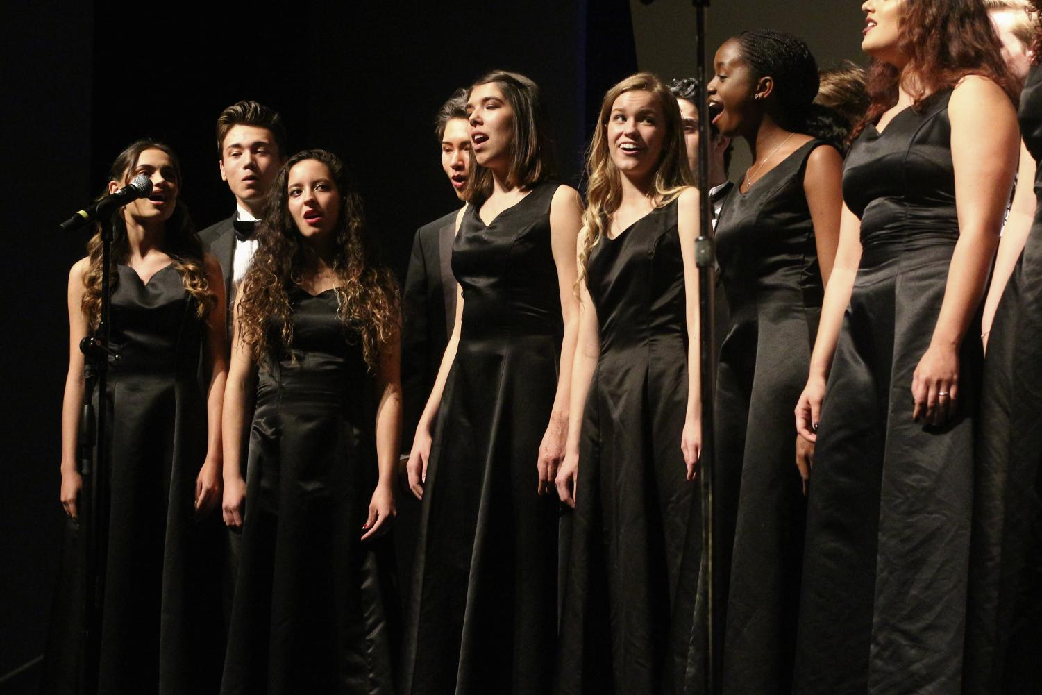 "Vocal senior Grace Barrett sings alongside her fellow choir members as they open with ""Alleluia"" by Paul Basler. Before the show started, vocal dean Ken Taylor addressed the audience, saying, ""Enjoy this next little while as we conclude our year and celebrate with everyone—but especially with our seniors—with some really fine music tonight."""