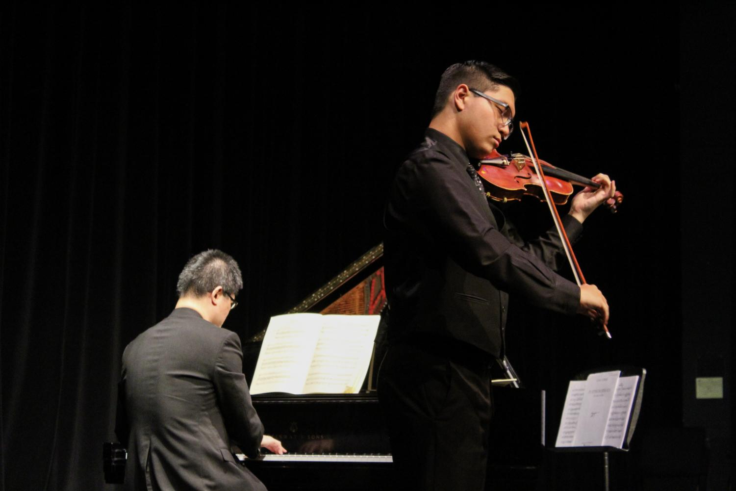 """Hakkarainen's and Mr. Lin's performance was an artistic conversation. In strings senior Elliot Weber's program notes, they write that the Mozart Sonata K 526 """"diverges from the traditional sonata by opening with a duet between the violin and piano,"""" indicating that the two instruments have """"equal importance."""""""
