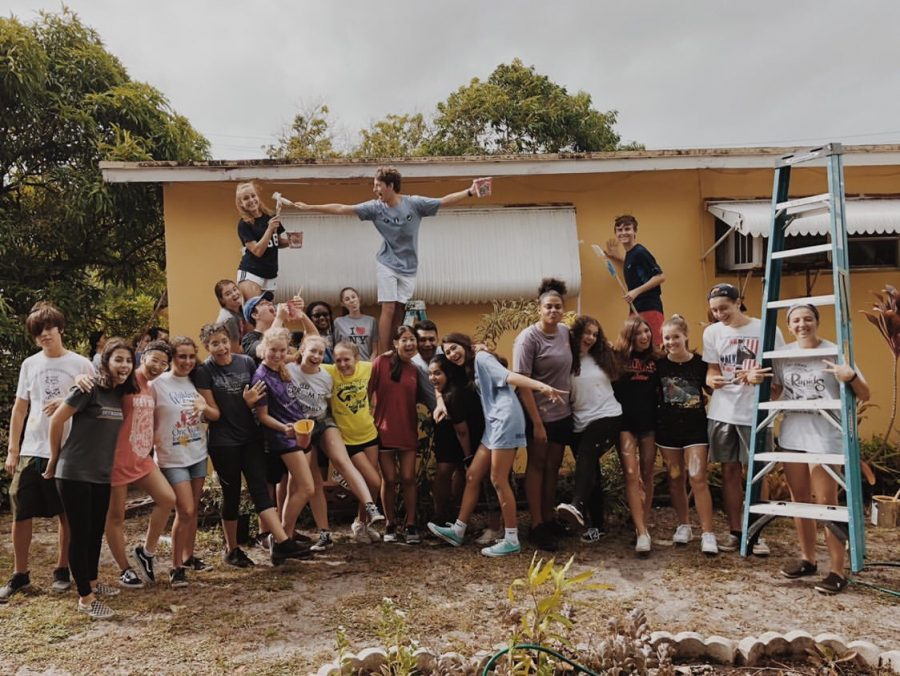 Standing in front of the house they had just painted, sophomores finish Paint Your Heart Out. The photo was posted on the Class of 2022 Instagram page.