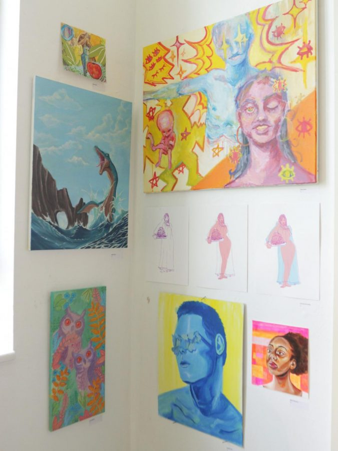 """Pieces were arranged by color scheme and thematic elements as part of the """"salon-style"""" setup."""