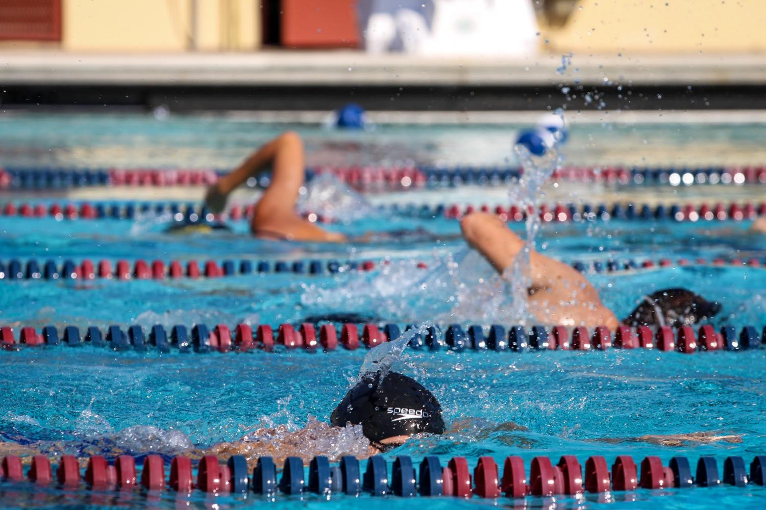 """The swim team practices at Gaines Park in Warren Hawkins Aquatic Center. They train hard for upcoming districts. """"We practice being able to pace ourselves by doing a lot of cardio and endurance training,"""" visual sophomore Julie Akdag said."""