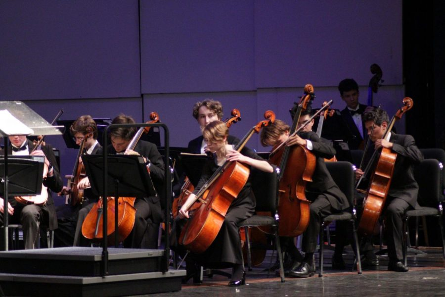 Students+warm+up+on+the+cello+before+strings+teacher+Wendell+Simmons++comes+on+stage+to+conduct+the+first+concert+piece%2C+%E2%80%9CFrom+the+Seraglio%E2%80%9D+by+Mozart.+Originally+composed+for+an+opera+in+the+1780s%2C+commissioner+and+Holy+Roman+Emperor+Joseph+II+said+on+its+opening+night%2C+%E2%80%9CToo+lovely+for+our+ears%2C+and+far+too+many+notes%2C+my+dear+Mozart%21%E2%80%9D+It+was+the+most+complicated+piece+in+German+history+at+the+time+of+its+creation.+