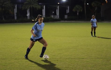 """Vocal sophomore Kira Winston plays up on the ball at practice. """"Practice goes into everything we do,"""" Winston said. """"In order to be ready for [the showcase in] Texas, we need to practice as much as we can."""" (Anna Jones)"""