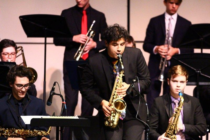 "Band major David Galli performed a saxophone solo during the concert on Wednesday. ""Is [Jazz] it a lifestyle? Is it a music genre?"" Galli said.""[It's important] to [remember] the original African American traditions."""