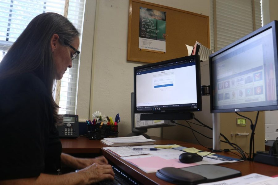 Signing into her school district portal, ESE Coordinator Julie Craver finishes her tasks before an upcoming meeting. 