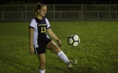 """Playing left back, theatre sophomore Grace Trainor juggles the soccer ball during warm-ups in preparation for their game against Santaluces High School. """"It was a good season opener,"""" Trainor said in reference to their tie. """"We have a lot to work on."""""""