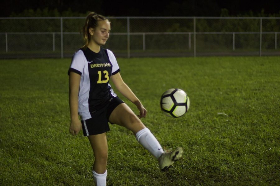 "Playing left back, theatre sophomore Grace Trainor juggles the soccer ball during warm-ups in preparation for their game against Santaluces High School. ""It was a good season opener,"" Trainor said in reference to their tie. ""We have a lot to work on."""