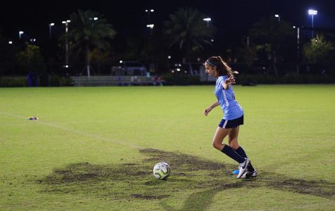 """Band freshman Ava DeGaetano trains at Gardens District Park three times a week after school. She balances her busy schedule to fit in her two-hour practices. """"Practices are my favorite part of the day,"""" DeGaetano said. """"I love playing with my teammates."""""""