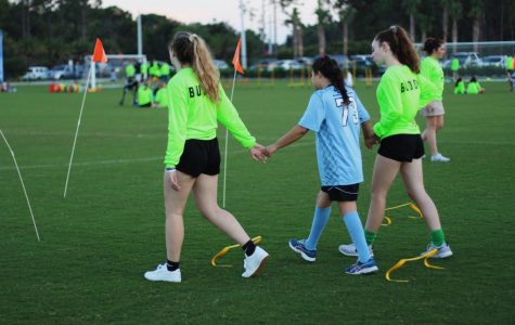 """TOPSoccer volunteers help their buddies participate in a drill before the end of the session scrimmage. """"They all get so happy and excited when kicking the ball,"""" communications freshman Cameron Wilson said. """"It's the little things that make their day and mine."""""""