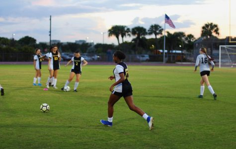 """Band freshman Ava DeGaetano receives the ball from a teammate in preparation for their game. They focused on pass accuracy during the warmup, a strength the soccer team has been working on. """"We connect very well with each other,"""" DeGaetano said, """"on and off the soccer field."""""""