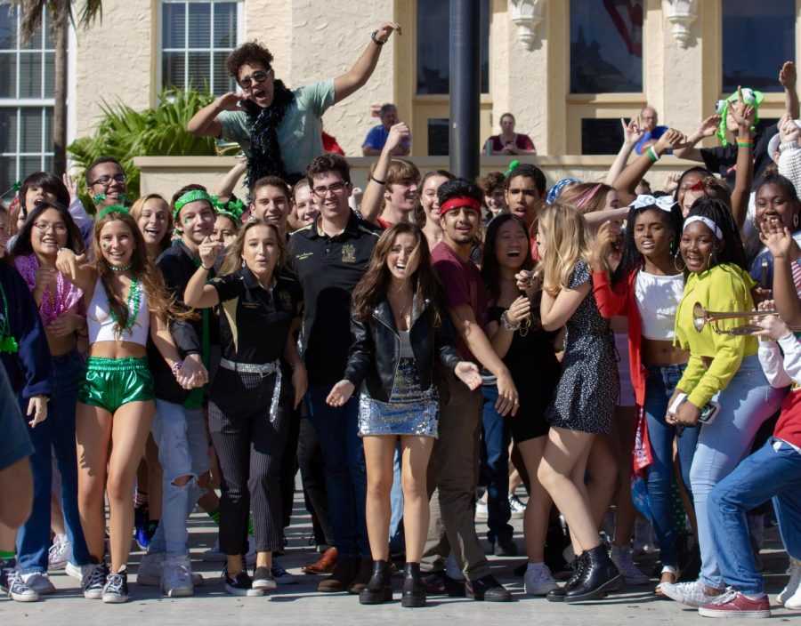 SGA+co-presidents+Kristina+Ronan+and+Sebastian+Fernandez+cheer+alongside+students+from+other+classes+as+the+last+shot+of+the+Lip+Dub+is+filmed+at+the+front+of+the+school.+Students+get+on+top+of+each+other%E2%80%99s+shoulders+and+wave+around+props+from+their+own+costumes+to+be+seen+in+the+drone+shot.
