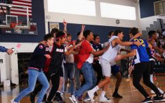 "Juniors celebrate their dodgeball victory over the seniors. With first place in the game, juniors brought their total number of Spirit Week points to 40, tying with the seniors for the most points. ""I think we won because we all had great teamwork,"" theatre junior Christopher Hesse said. ""We all were really dedicated to the cause, and we know that this is going to be the year that the juniors beat the seniors, and so we were all so devout to that one cause that we just went bananas."""