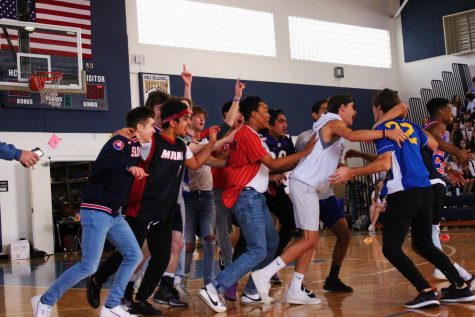 """Juniors celebrate their dodgeball victory over the seniors. With first place in the game, juniors brought their total number of Spirit Week points to 40, tying with the seniors for the most points. """"I think we won because we all had great teamwork,"""" theatre junior Christopher Hesse said. """"We all were really dedicated to the cause, and we know that this is going to be the year that the juniors beat the seniors, and so we were all so devout to that one cause that we just went bananas."""""""