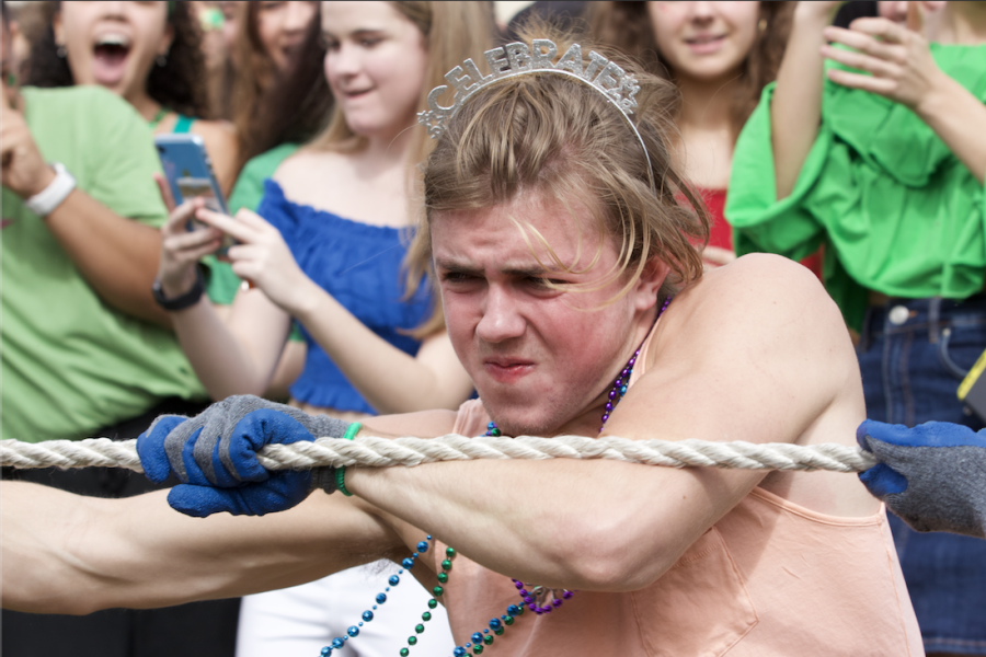"""In a last round competition against the sophomores, communications senior Tommy McCabe tugs at the rope to help the senior class win the game. The seniors lost to the sophomores, leading to a final round between the sophomores and juniors. """"This year [seniors] got third, and I'm a little hurt,"""" McCabe said. """"I mean, last year, [the class of 2020] beat the seniors and we won; we got first place."""""""
