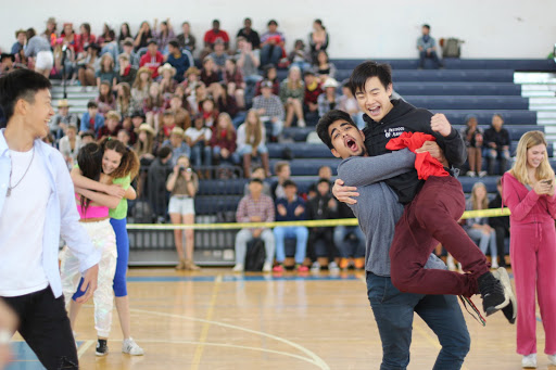 "Raising piano junior Ethan Cheung into the air, vocal junior Arman Koshbin celebrates the juniors' victory in ""Knight, Mount, Carry."" Cheung had the opportunity to compete alongside piano junior David Liu. ""Before the game, David and I created a strategy to win,"" Cheung said. ""We're both really good friends and have established chemistry."""