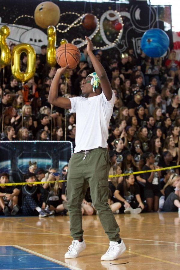 """Piano Sophomore Chris Samuel shoots free throws in the basketball game an attempt to win for his class.""""I thought I was gonna do better than I actually did,"""