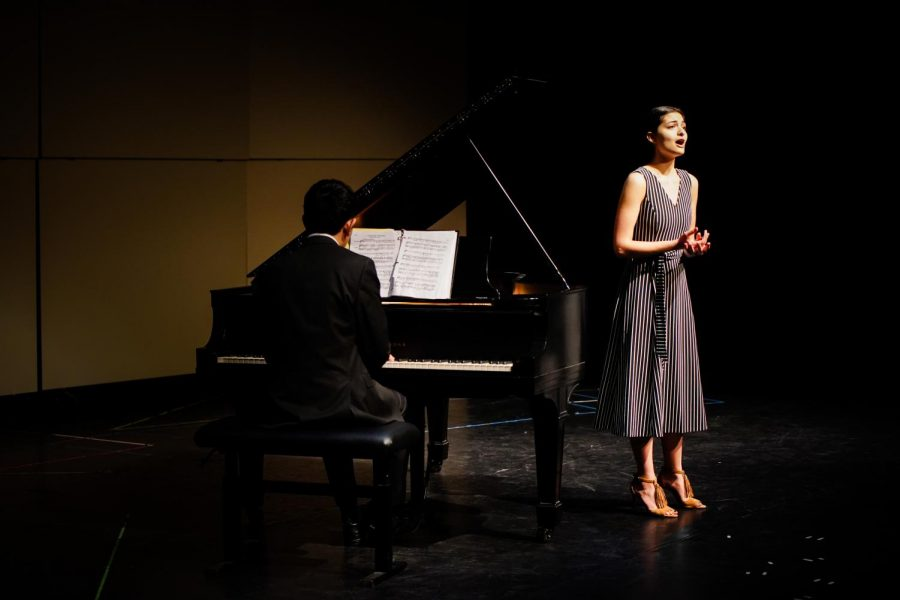 """Piano junior Jason Ibalarrosa and vocal senior Isabella Caggiani perform Johannes Brahms' """"Vergebliches Ständchen,"""" a humorous dialogue between two lovers. """"The male is trying to seduce the female, and the female is not having it"""" said Caggiani, who sang both the male and female parts."""