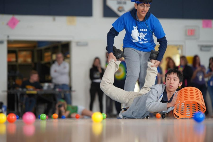 Freshman Class Council President Jayantha Kantamneni rolls his co-president Nam Tang around in a game of Hungry,Hungry Hippos.