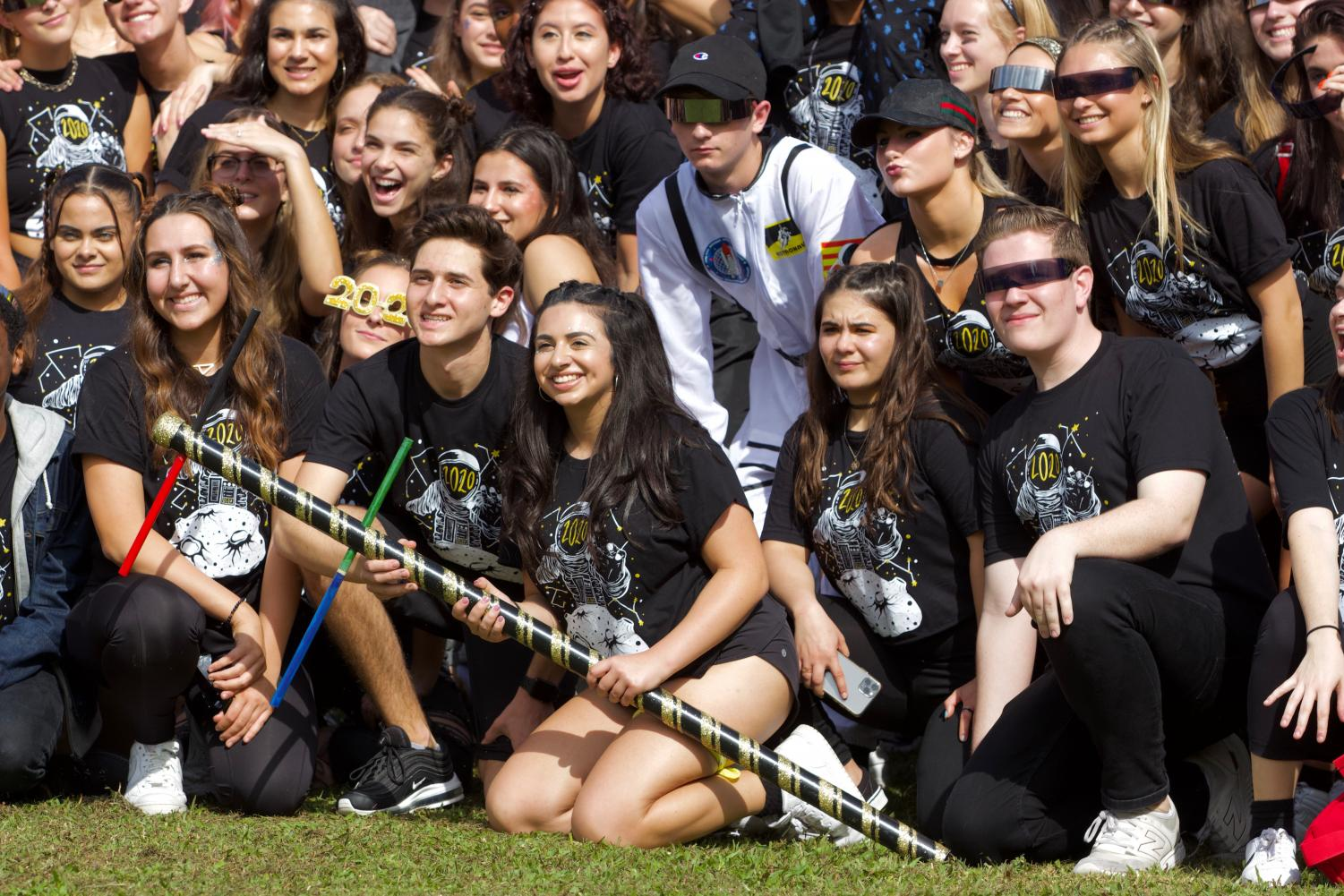 Senior Class Council president Nikolas Zimmerman holds the spirit totem pole with his co-president Mara Vaknin as the entire class celebrates their victory for spirit week.