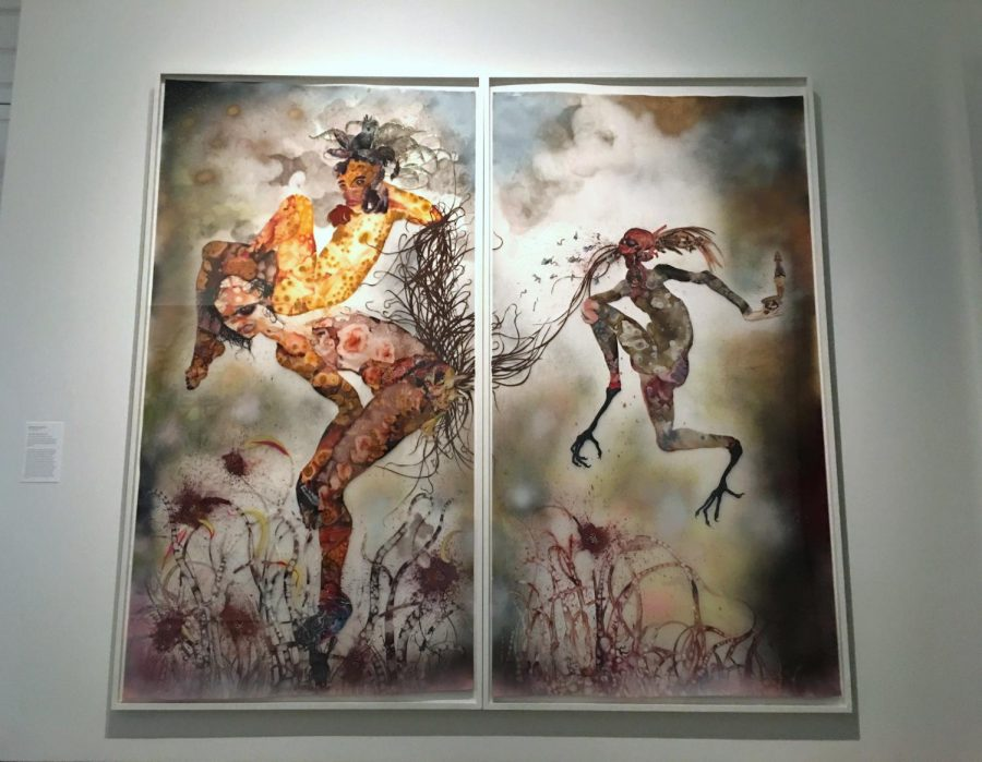 "Wangechi Mutu's piece, ""Your Story, My curse,"" hangs in the Norton Museum of Art.  Mutu, an African artist, used collage pieces, mylar paper, and glitter to construct her characters. ""It's pretty much all over the place, but I think that kind of speaks for her art,"" theatre junior Mayah Bernstein said.  ""A lot of her art reflects consumerism and… representation of African women in the media."""