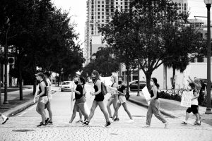 Protestors cross the street.