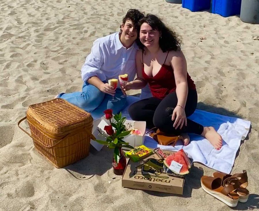 Kayla+Esther+Zakarin%2C+right%2C+and+her+boyfriend%2C+left%2C+sit+on+the+beach+holding+wine+glasses+filled+with+cake.