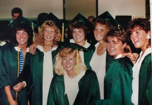 "Mrs. Zietz's high school graduation in Bloomington, Illinois. Her friend Leslie is second-left, Mrs. Zietz is in the middle, and Buffy is third-right. The friends since ""have a monthly Zoom call, plus three more not pictured,"" Mrs. Zietz said. ""Every one of these girls were in the cornfields that night!"""