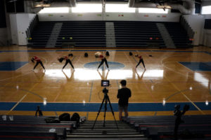 Communications senior Adam Goldstick records dance juniors Kailey Worontsoff, Lauren Hopta, Sophia Chambers, and Jacqueline Albanese as they perform the junior class pep-rally dance.
