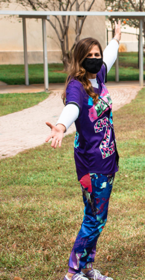 Principal Blake Bennett sports graphic pants and a jersey to pay homage to the 1980s. Photo by Allison Robbert.