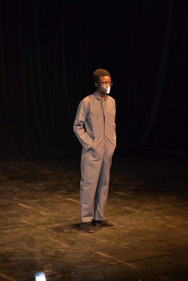 On an empty Black Box stage, a spotlight shines on theatre junior Schandè Saintil. Photo by Natalie Ryder.