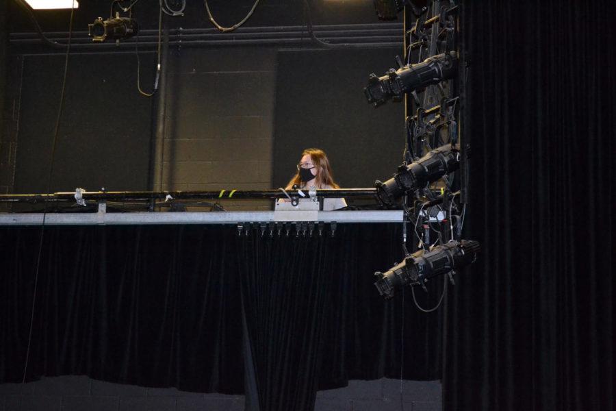Theatre Junior Sofia Tartakovskaya adjusts the stage lights. Photo by Natalie Ryder.