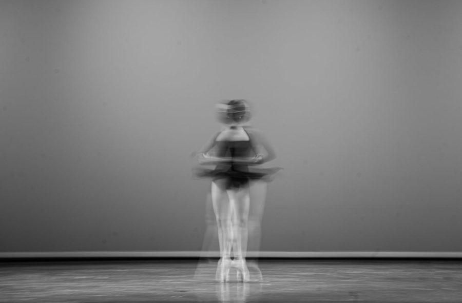 "Dance senior Ashley Nazzar twirls on stage in Meyer Hall during the ""Immunity"" showcase. Photo by Allison Robbert."