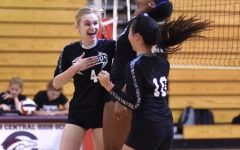 After a point by outside hitter and visual senior Julia Gonello, band senior Autumn Wong  and graduate Czhen Beneby celebrate together in a game against Palm Beach Central during the 2020 volleyball season. Photo courtesy of Autumn Wong.